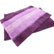 Purple rubber backed rugs.