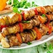 Kabobs on a serving plate.