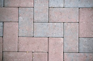 Close up of a red brick patio.