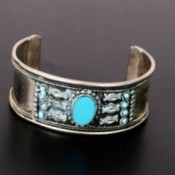 A turquoise and silver bracelet.