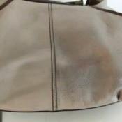 A leather bag that has been cleaned with a magic eraser.