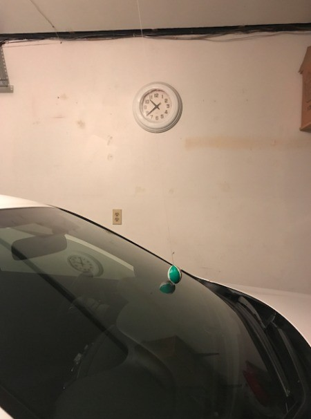 Using a tennis ball to mark how far to park in your garage.