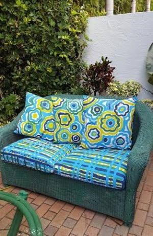 Colorful New Look for Faded Patio Pillows - finished pillows on couch