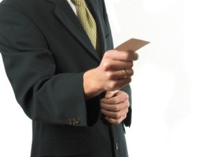 A man holding a business card.