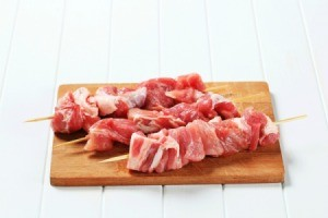 Raw pork on skewers.