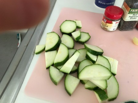 Zucchini pieces on cutting board