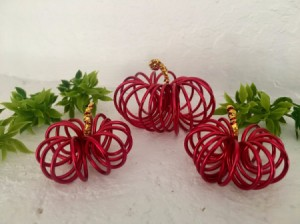 Mini Floral Wire Pumpkins - pumpkins arranged with some greenery