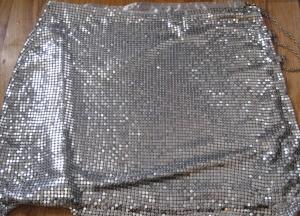 A dress made from a metallic mesh fabric.