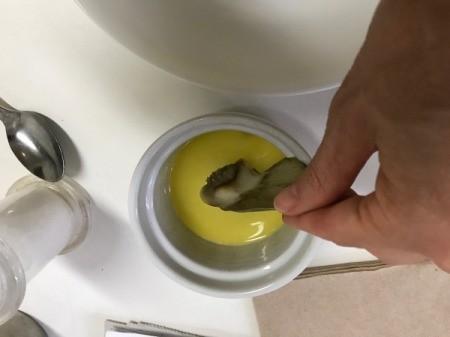 dipping artichoke leaf in butter