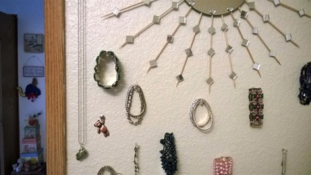Jewelry being displayed using pushpins.