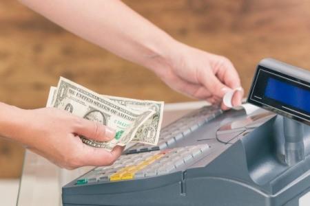 A cashier refunding cash to a customer.