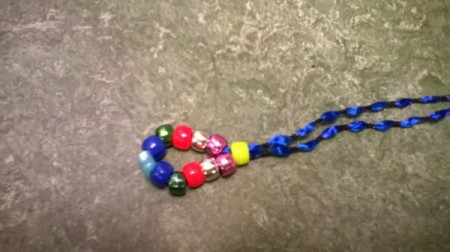 Closeup of single bead pushed up against the center beads.