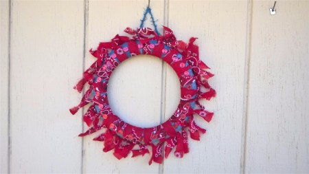 Denim and Bandanna Wreath - finished wreath hanging on an exterior wall