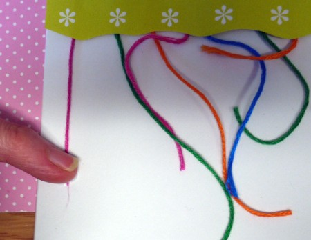 Hanging Baubles Greetings Card - pull each strand of floss taut and glue down