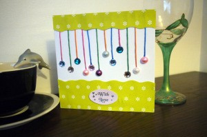 Hanging Baubles Greetings Card - finished card on table top