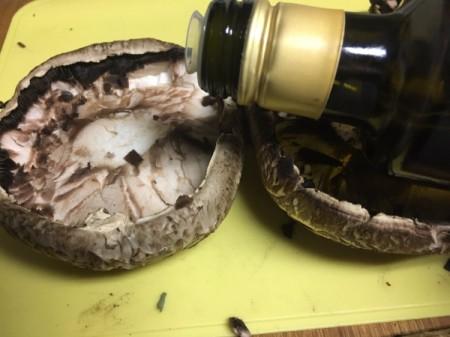 adding olive oil to Portobello Mushroom