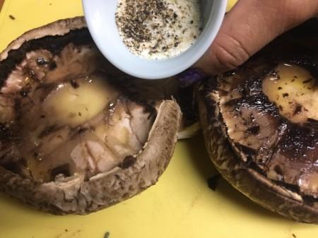 adding herbs to Portobello Mushroom