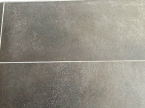 Talcum powder on a dark grey tile floor.