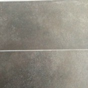 Talcum powder on a dark grey tile floor.