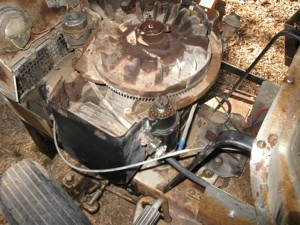 A lawn mower engine with the covering removed.