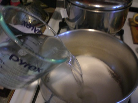 adding vinegar to sugar