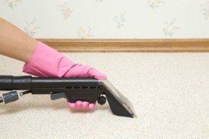 Using a carpet cleaner to remove odors from carpet.