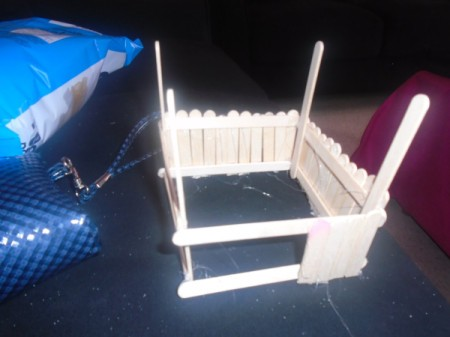 Popsicle Stick Gazebo and Bench - glue the cut sticks vertically to the three sides