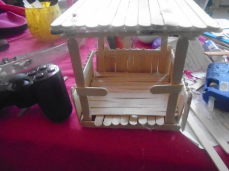 Popsicle Stick Gazebo and Bench - glue cut sticks to front roof supports