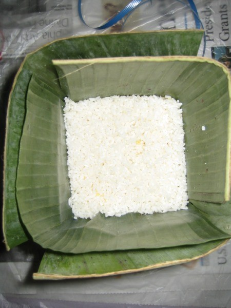 Sticky Rice added to banana leaf