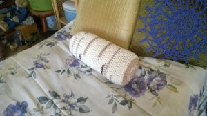 """Crocheted """"Timber"""" Neck Pillow Pattern - finished pillow on bed"""