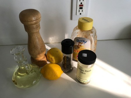 The ingredients for homemade honey-lemon salad dressing.