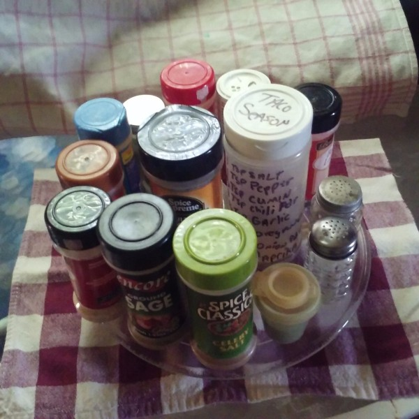 a collection of spices on a glass tray used in a microwave