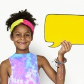 A girl holding a speech bubble.