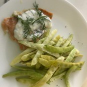 Baked Salmon with Dill Sauce and beans on plate