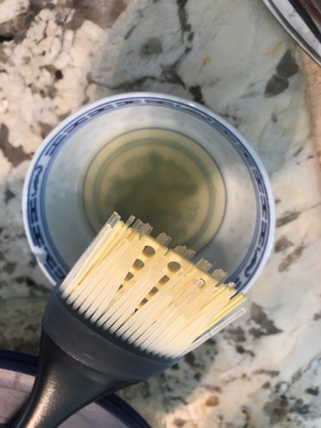 Oil and a brush, for preparing the grilled artichokes.