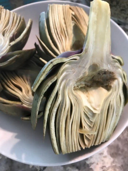 The artichoke halves, ready for grilling.