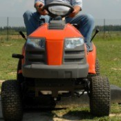 A riding mower cutting grass.