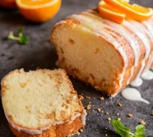 An orange loaf cake covered in glaze.