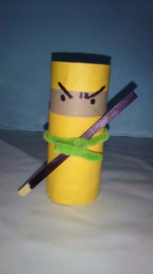 A completed ninja made from a recycled toilet paper roll.