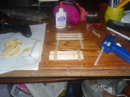 Popsicle Stick Gazebo and Bench - cut two sticks to fit the bench's seat depth and glue in place
