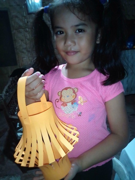 Making a Paper Lantern - little girl holding the lantern