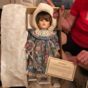 Value of a Seymour Doll - doll wearing a floral dress and hat in box