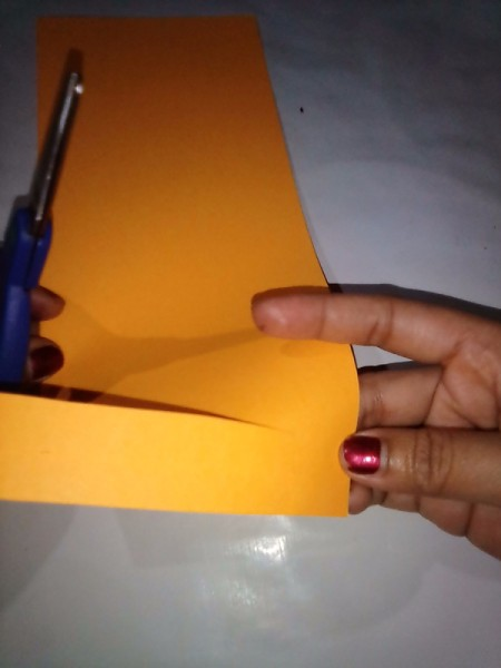 Making a Paper Lantern - begin making cuts toward the folded edge leaving approximately 2cm uncut