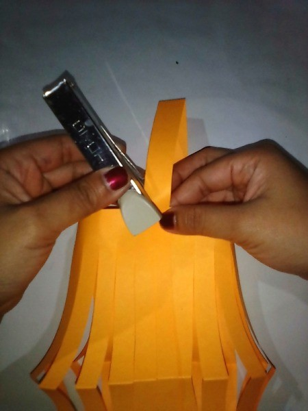 Making a Paper Lantern - staple on the handle