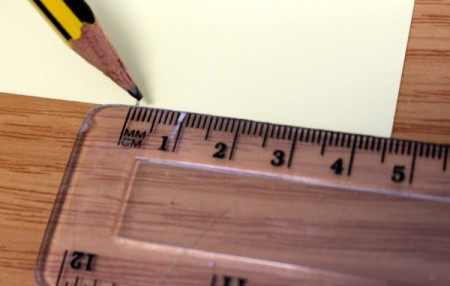 Marking 4.5 inches on a piece of paper.