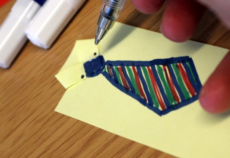 Adding button details to the tie bookmark.