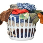 A laundry basket full of clothes.