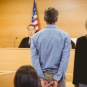 A defendant standing in court.