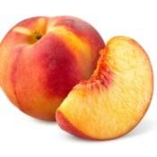 A photo of a whole peach and a peach wedge.
