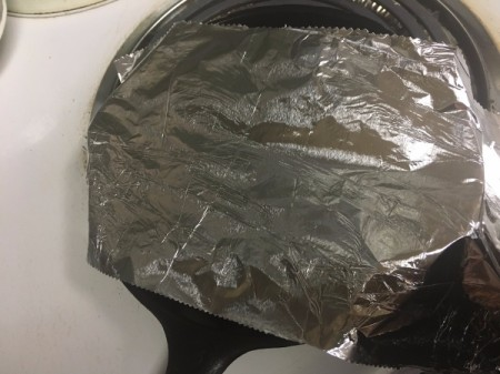 How to Prepare Ginkgo Nuts - Cover with foil and set to medium-high heat.
